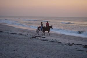 Beaches_CasualCouple_riding_1418172757224