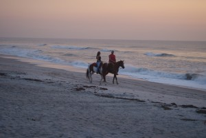 Beaches_CasualCouple_riding_1418172757224